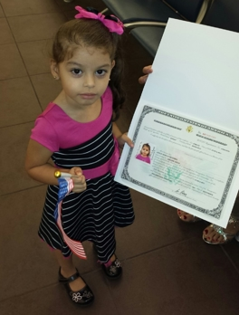 Young Girl with Birth Certificate